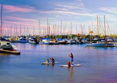 Kids Paddle Boarding by Lili Dingle