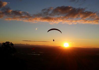 Mt Tamborine Sunset Paraglide 1 by Dom Colvile