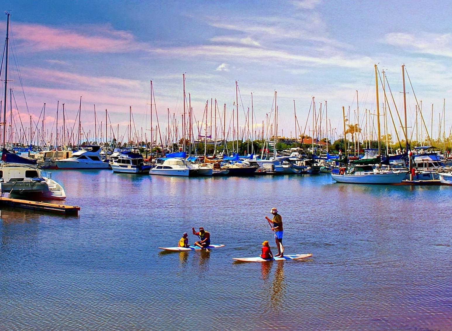 Kids Paddle Boarding by Lili Dingle