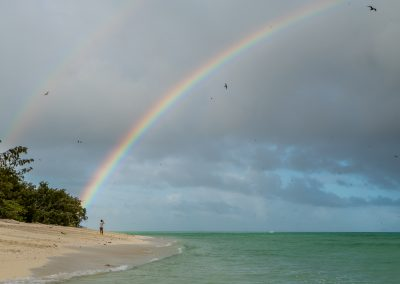 Coral Cay Double Rainbow by John McGrath