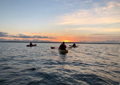 Sunrise Kayaking with Friends by Katrina Beutel
