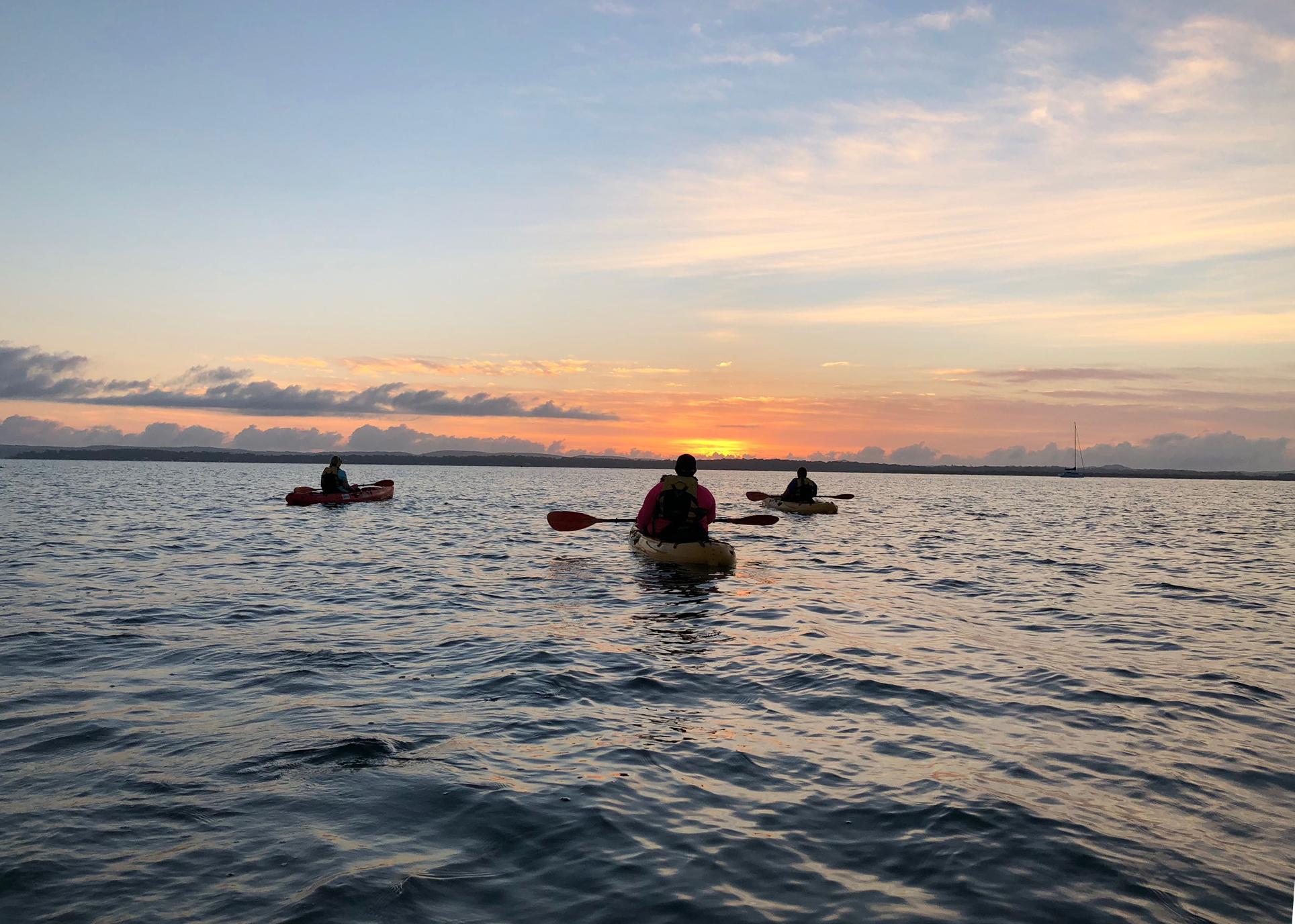 Sunrise Kayaking with Friends by Katrina Beutel